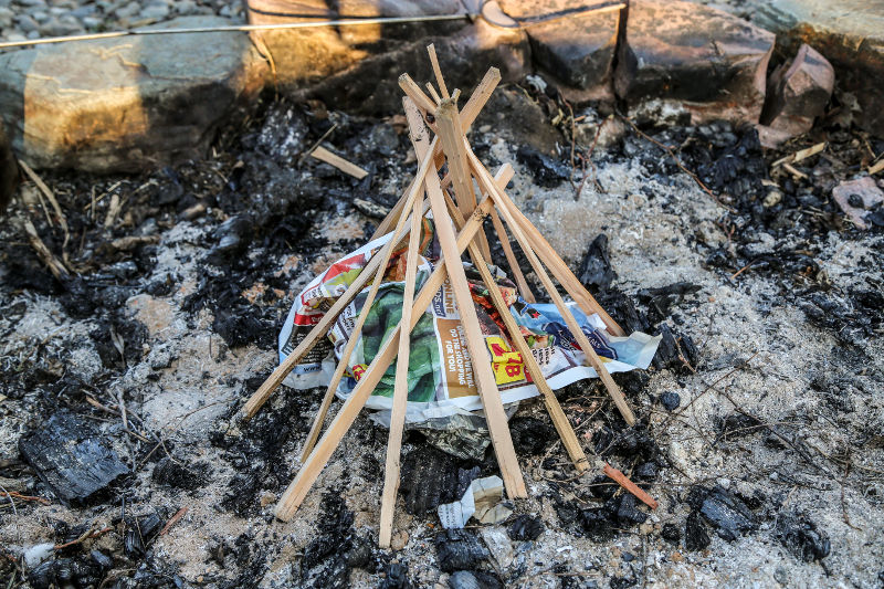 teepee campfire with newspaper tinder